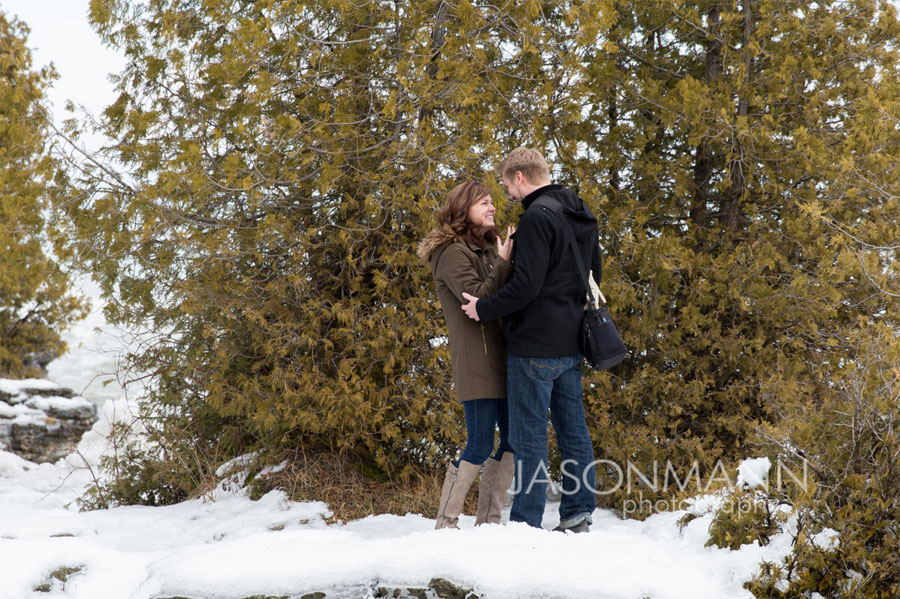 Door County Surprise Engagement at Cave Point in the Winter