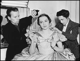 Monty Westmore and his assistant, hair styling department head Hazel Rogers, prepare Olivia de Haviland for Scarlett's wedding
