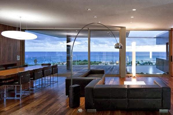 Fachada y planos de una casa moderna frente al mar for Casas modernas junto al mar