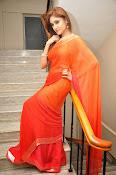 Sony Charista Glamorous in Saffron saree-thumbnail-7