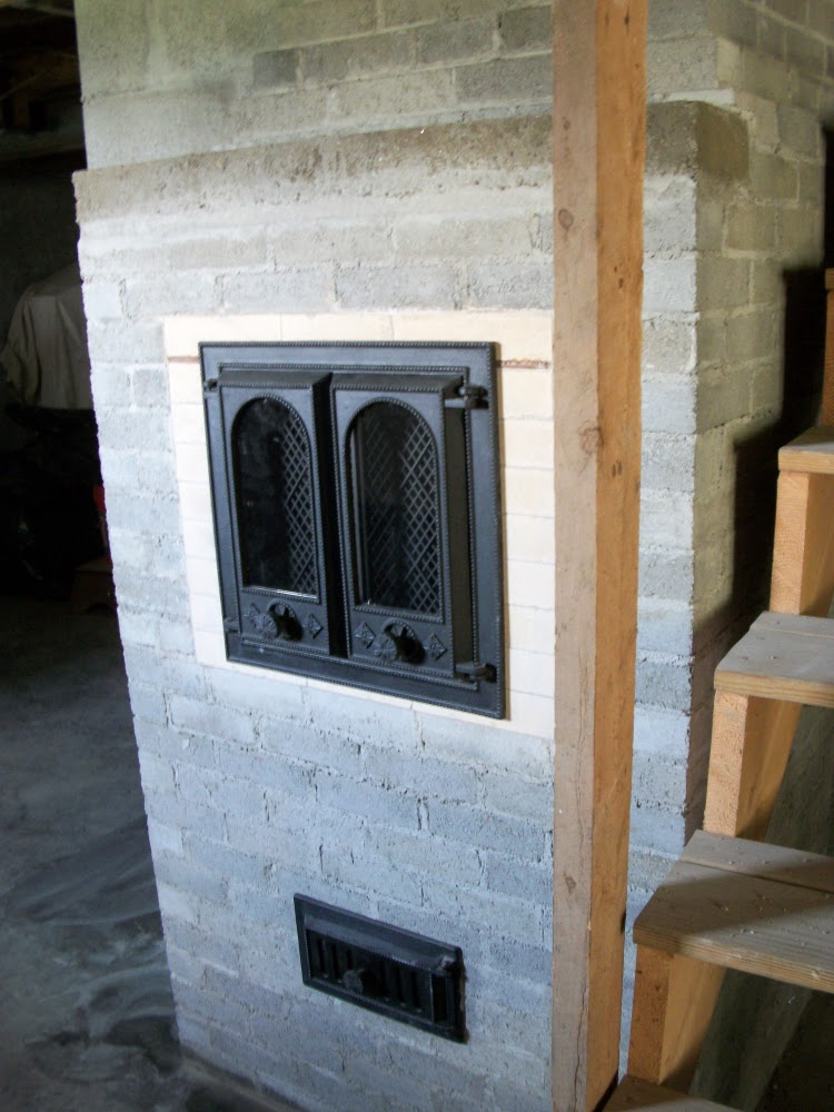 masonry heater in brookfield vermont with the wood fire in basement