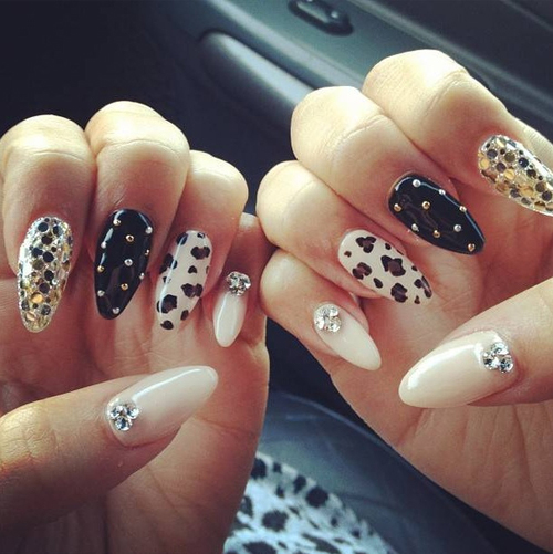 The Glamorous Dark golden nails animal print Photo