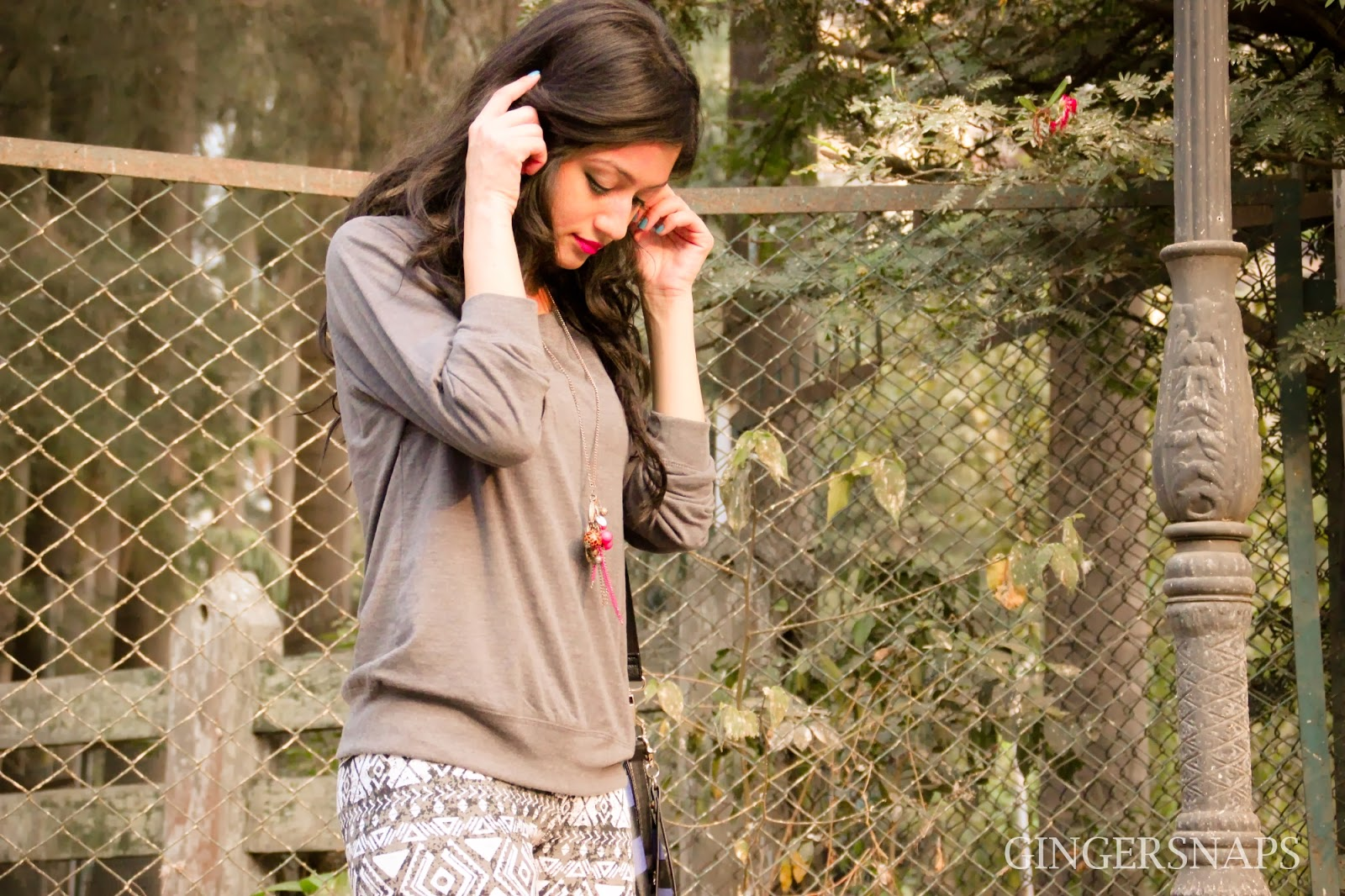 Karishma Rawat, Grey Pullover, Aztec Pants, Claire's Necklace