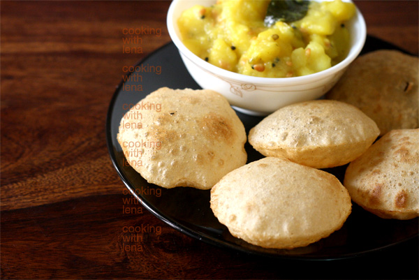Perfect, crispy and puffed pooris with potato masala