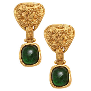 Vintage 1990's gold Chanel clip-on earrings with a dangling green stone embedded.