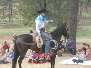 Cowboy in saddle with lasso