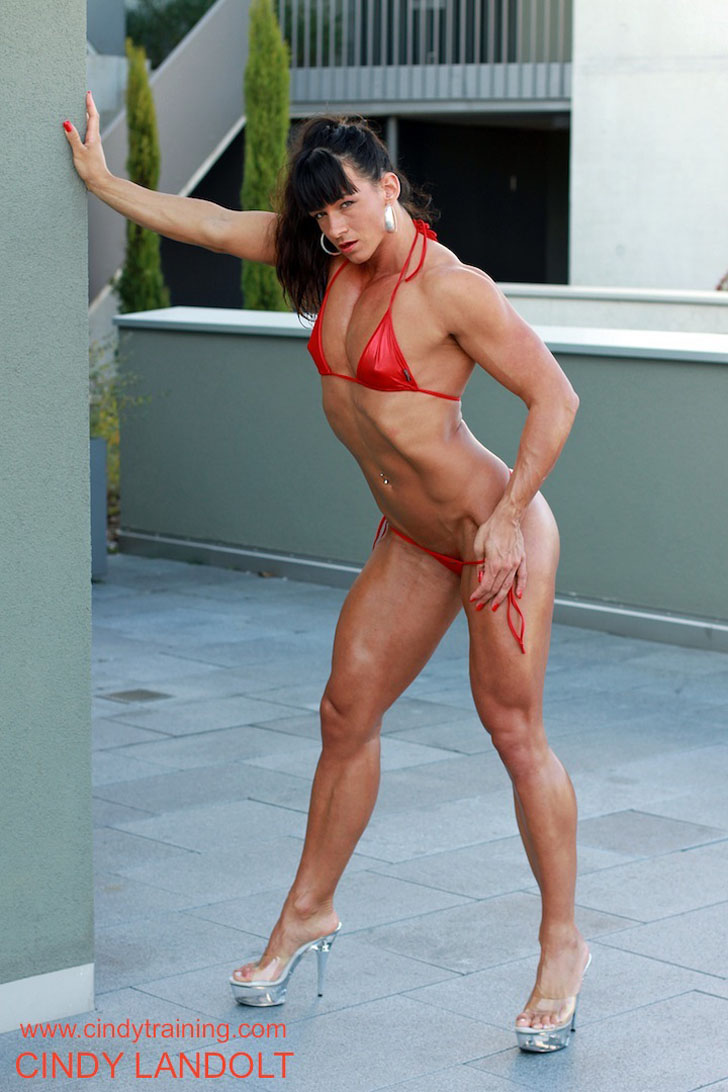 Cindy Landolt Posing Her Fit Muscles In A Red Bikini