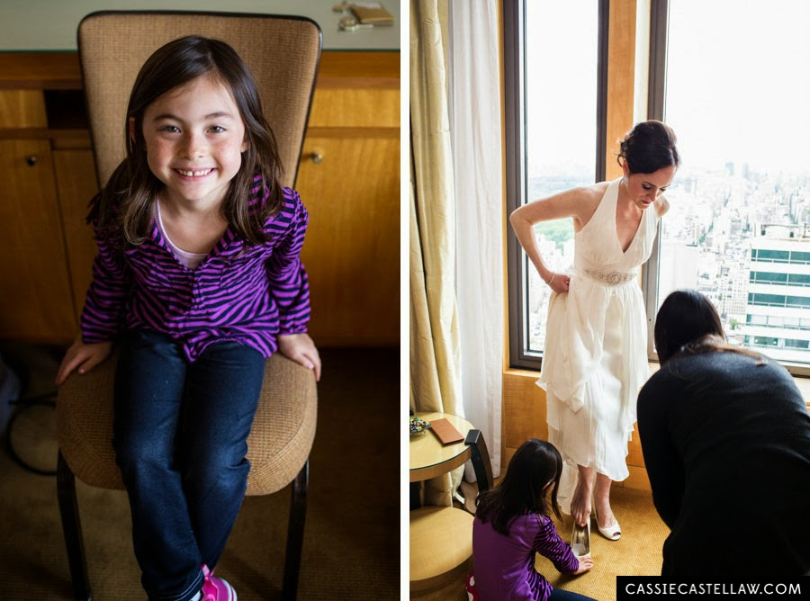 Adorable little girl helping the bride put on her shoes. NYC Lifestyle wedding photography by Cassie Castellaw. www.cassiecastellaw.com