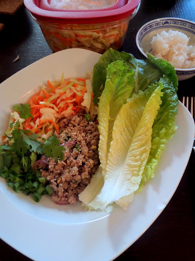 Larb:  A Laotion/Thai minced meat salad made with ground pork (or chicken), fish sauce, lime juice, toasted ground rice, and fresh herbs/vegetables.