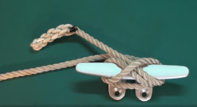 braided end of a rope tied onto a cleat
