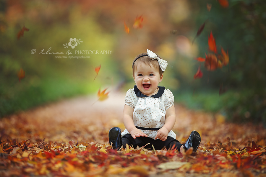 Happy Baby Girl with Fall Leaves