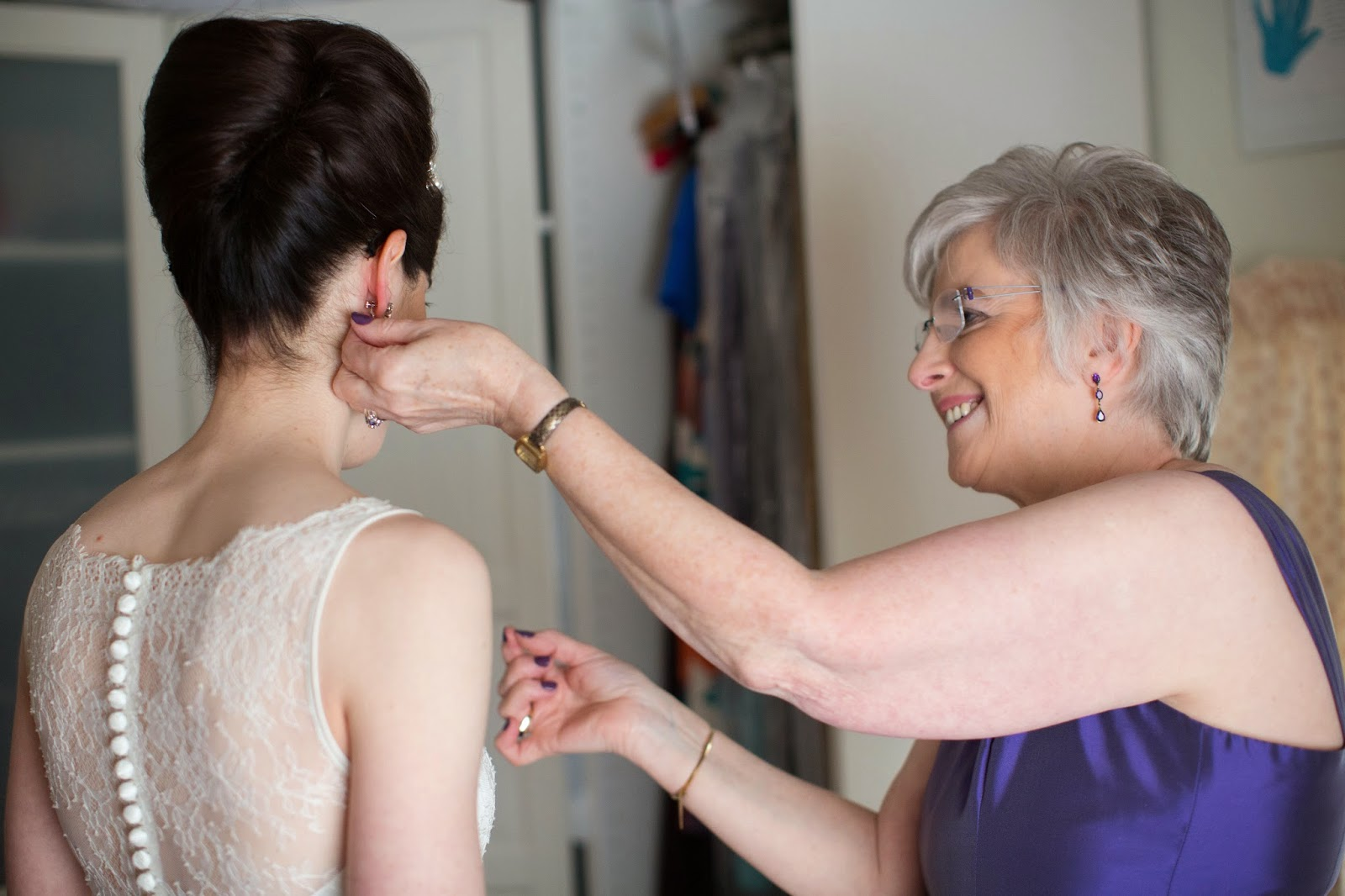 bride with her mum having final adjustments before leaving for her ceremony