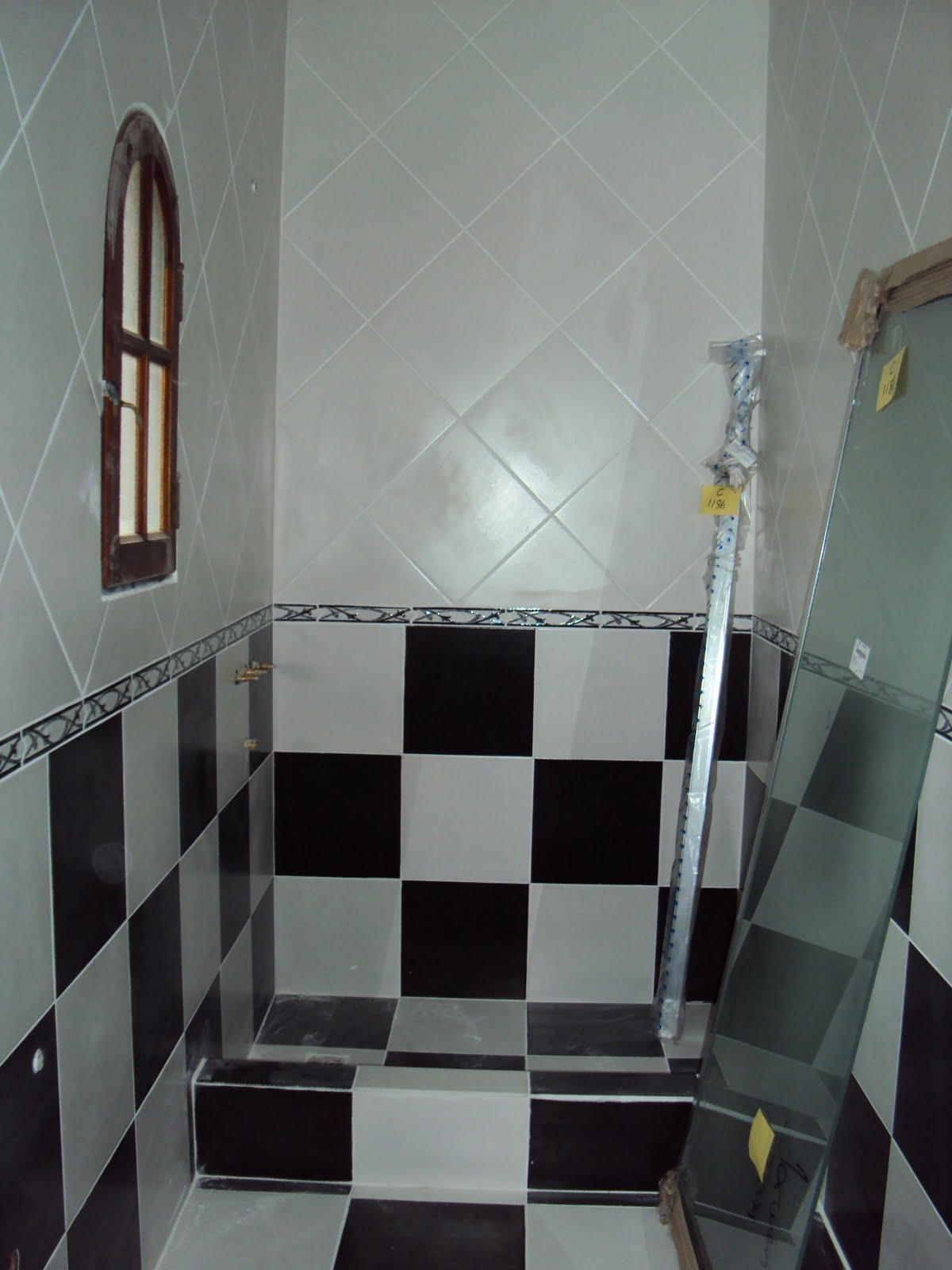 Baño Estilo Colonial:Laura Ramirez Construcciones: reforma baño estilo colonial