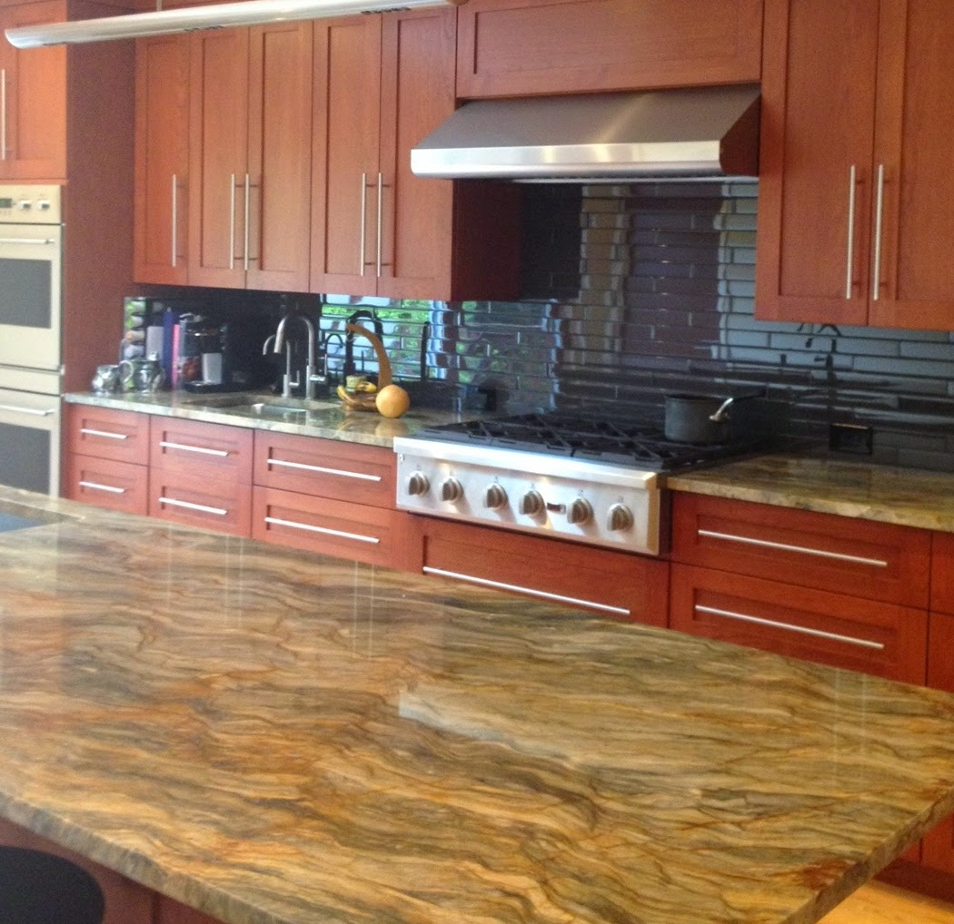 Dramatic Kitchen with Fusion Quartzite & Gray Glass Tiles