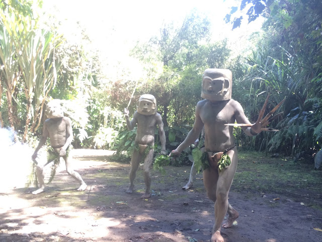 Men of Pogla village reenact the mudmen dance to scare off the Kuli tribe