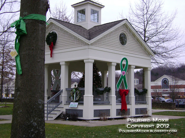 Image of pavilion in neighboring town to Sandy Hook decorated for Christmas and memoral for victims.