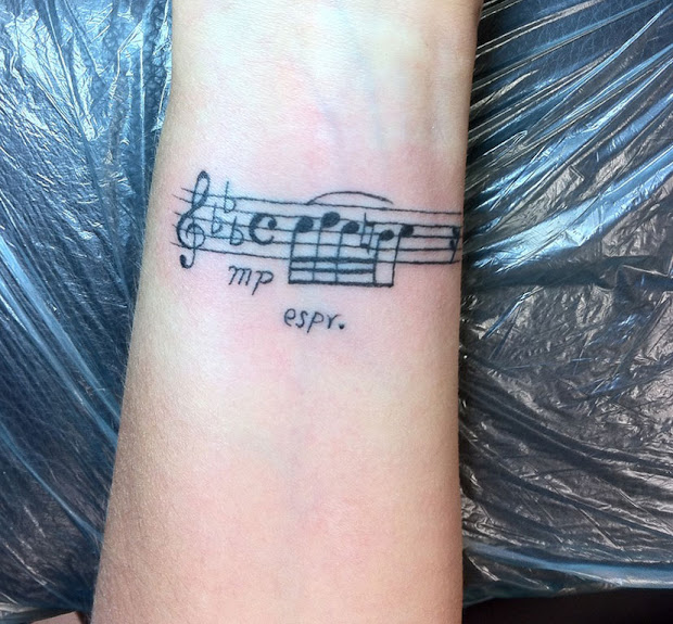 20 Music Note Hand Tattoos Ideas And Designs