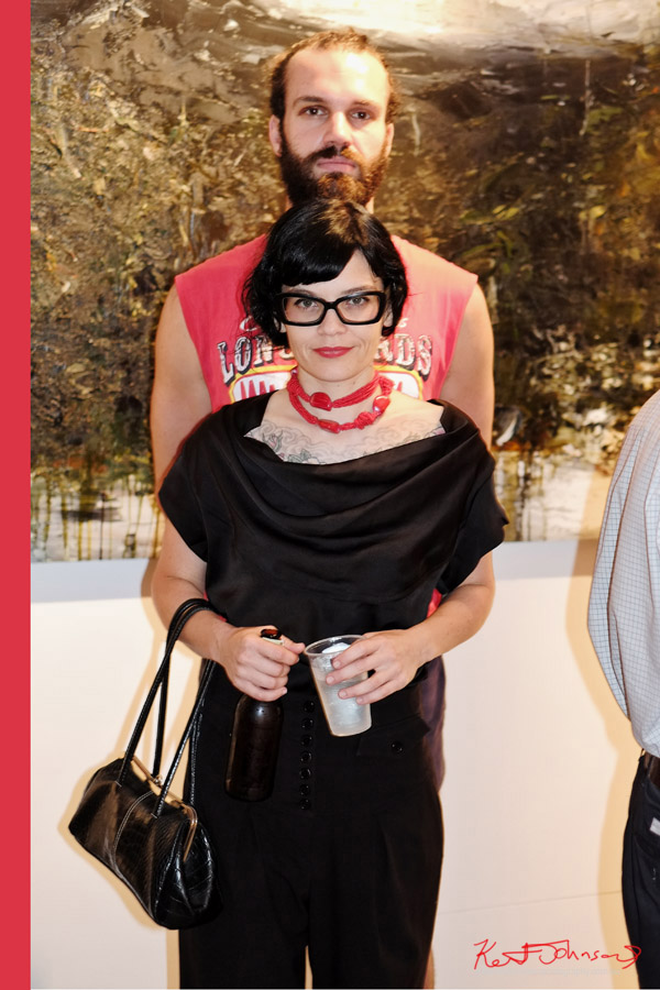 Double portrait, Art fashionistas style, black on black, heavy black glasses, red necklace, gallery Mick - official art bar Paddington Sydney.
