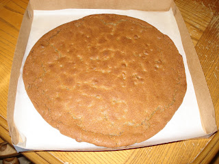 Place cooled cookie in pizza box.