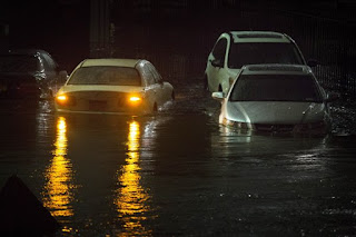flooded car, sandy