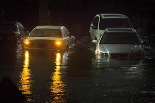 flooded car, sandy