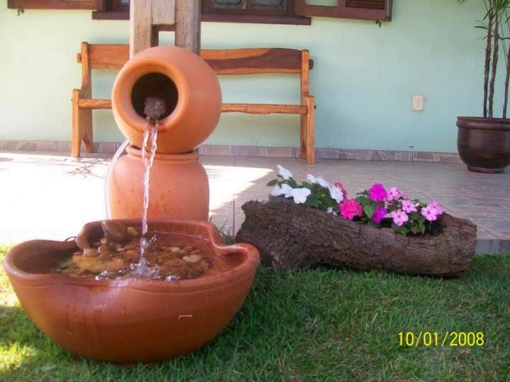 venda enfeites para jardim:para tornar os jardins mais charmosos, vejam com três vasos de