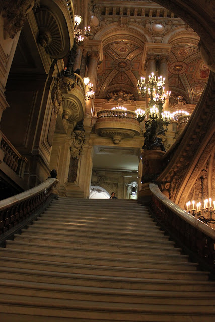 The first stairway leading to the main area of The Grand Staircase of Le Palais Garnier in Paris, France