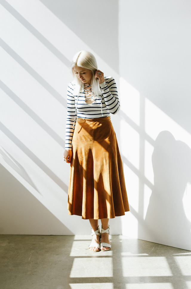 Fall Fashion Trends for 2015 are lace-up tops and suede! San Francisco Fashion Blogger, Stone Fox Style, shows how to wear falls biggest trend; midi suede skirts.