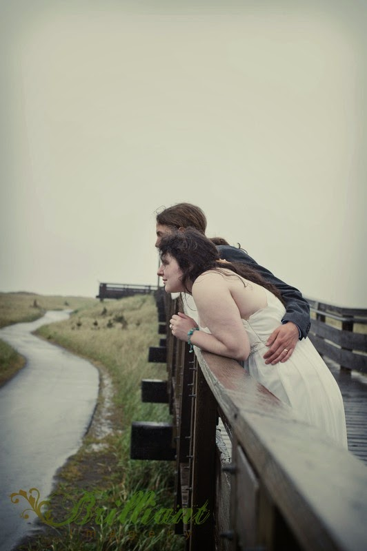 Alyssa and Nick on the boardwalk looking to the ocean - Patricia Stimac, Seattle Wedding Officiant