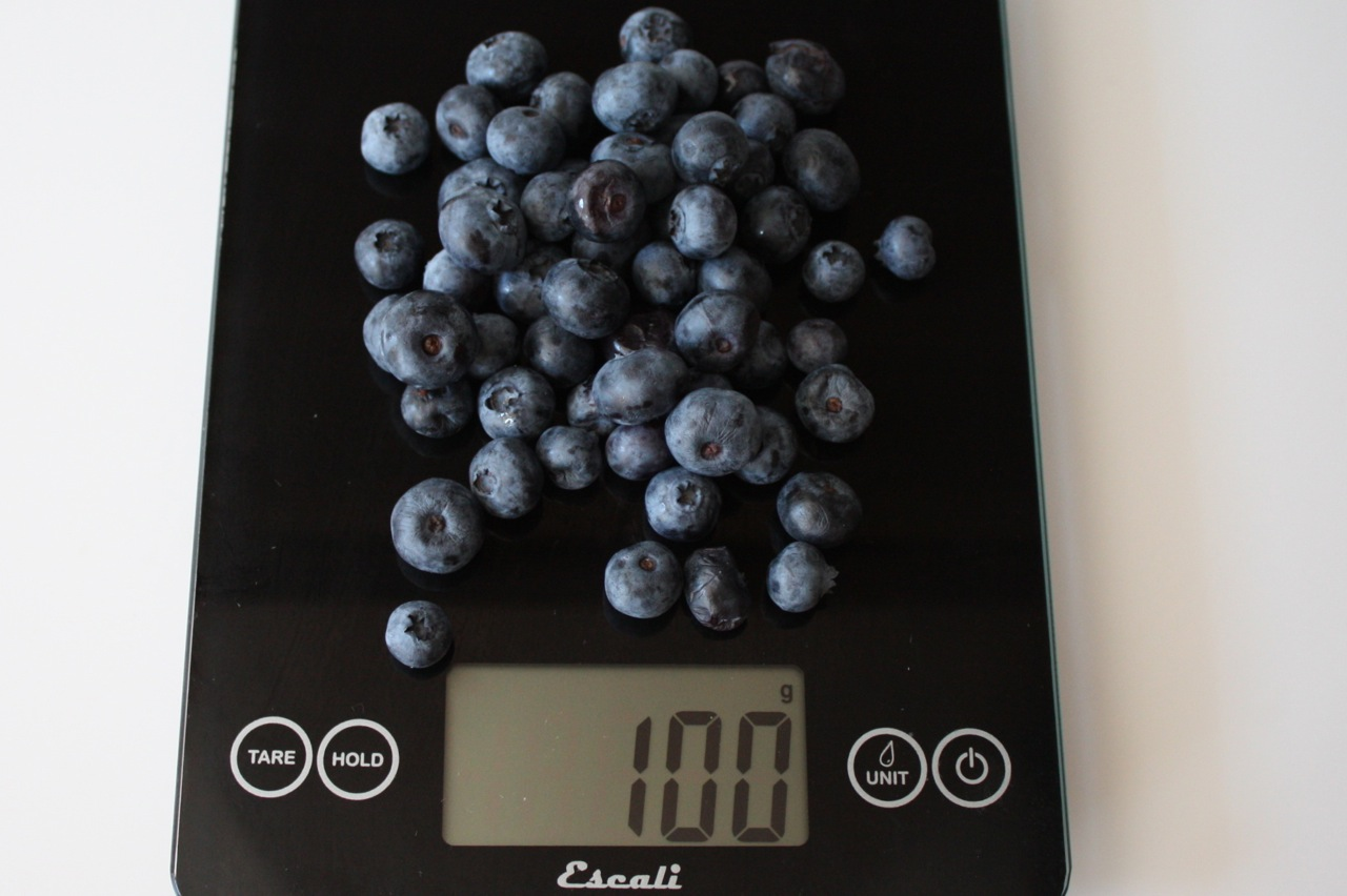 100 grams fresh blueberries shown on digital scale