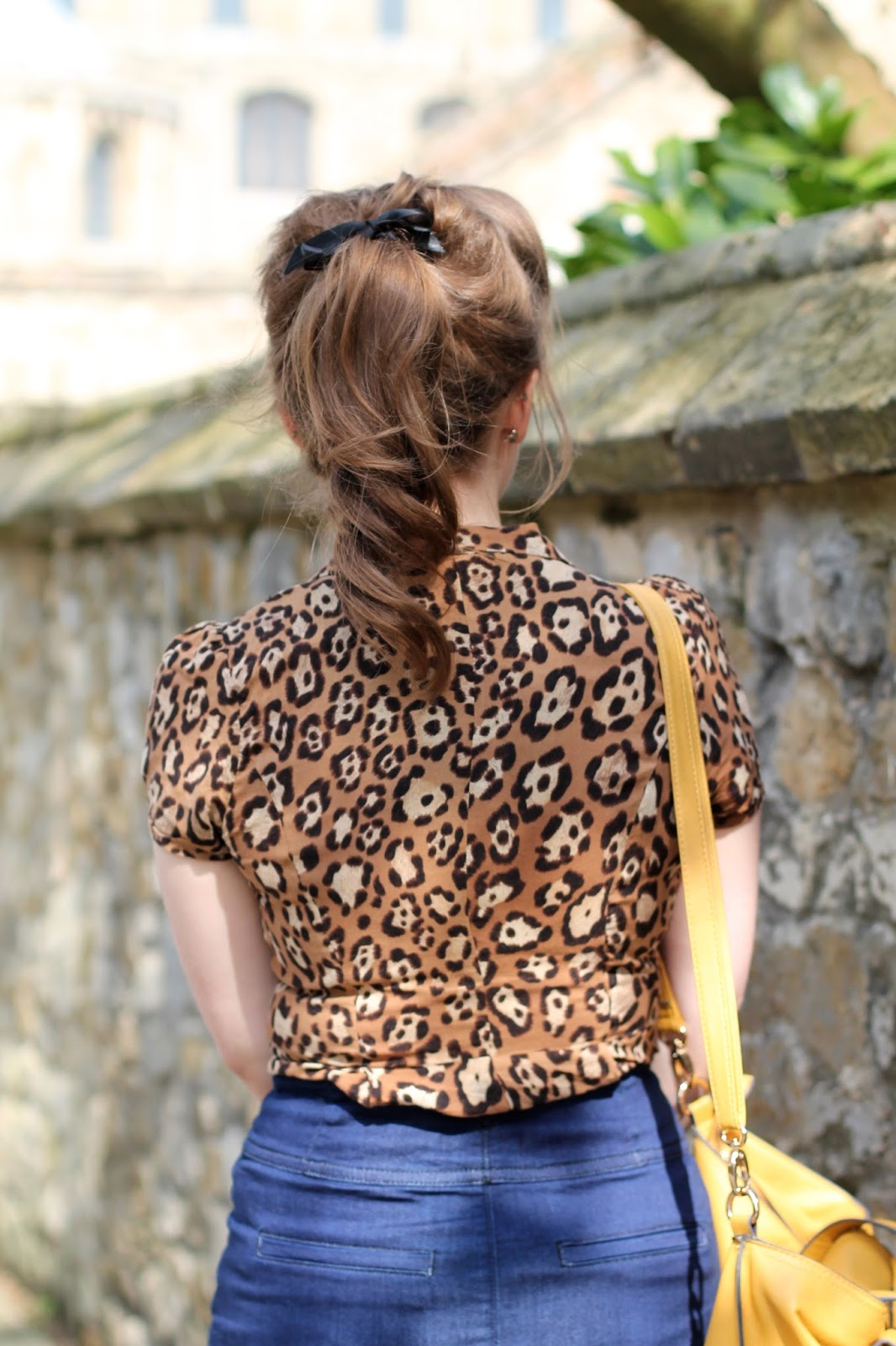Rockabilly look - ponytail, leopard print top, denim pencil skirt