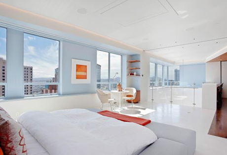 master bedroom with white decor in ritz carlton penthouse apartment