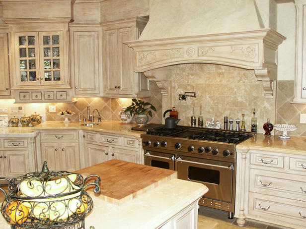 A Limestone Hood And Furniture Style Cabinetry With Three Different Color  Tones Ensures This Kitchen Reflects The Warmth And European Design Of The  Home.