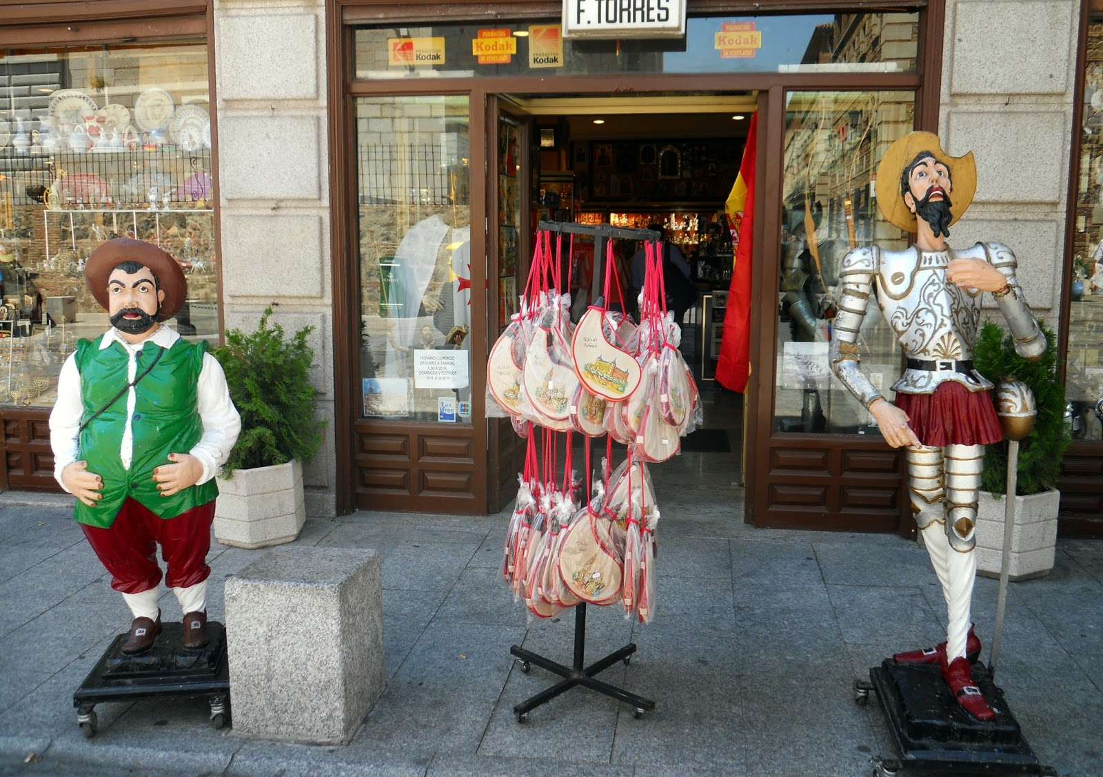 Figures of Don Quixote and Sancho Panza outside the gift shop at the Hotel Alfonso VI, Toledo
