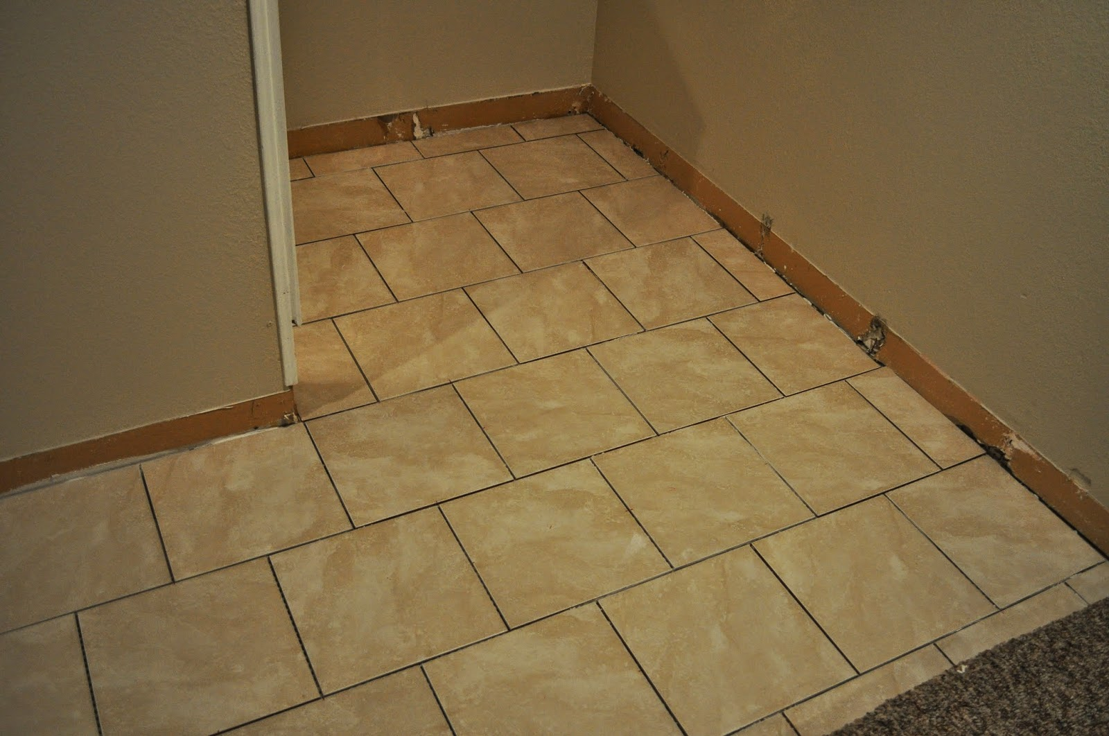 innovatile, accucolor, grout, light smoke grout, premium sanded grout, menards, tiling, tile, basement, project, diy, basement floor project, project