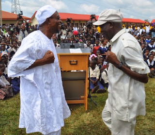 Aregbesola and Oshiomhole dancing