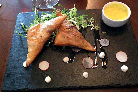 Samosas with raita.