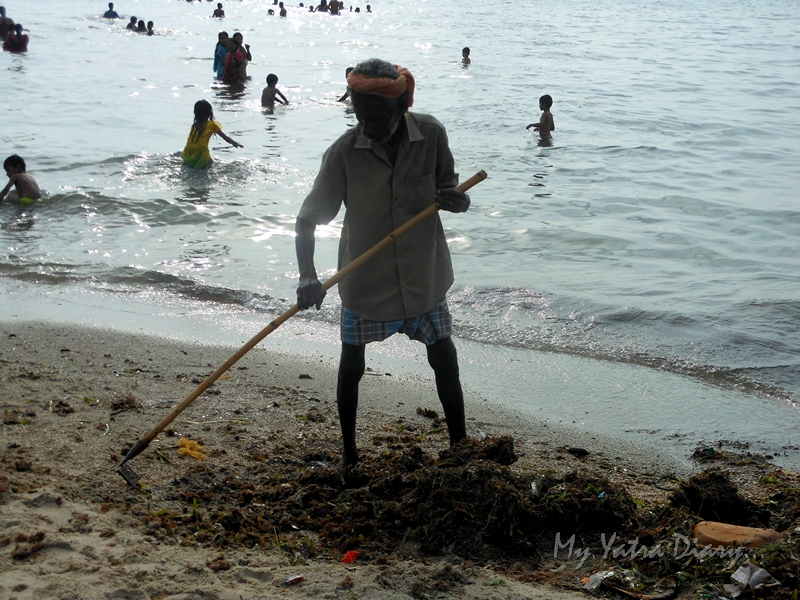 A man cleans the Rameshwaram Agni Teertham