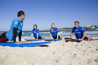 Surfing at Bondi Beach - image credit - www.sydney.com