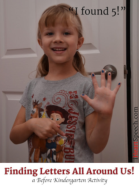 a before kindergarten child pointing to a letter on her shirt