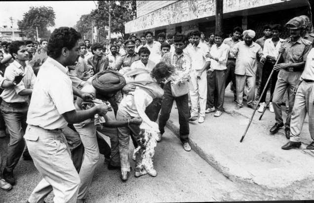 Student Rajiv Goswami attempting self immolation.