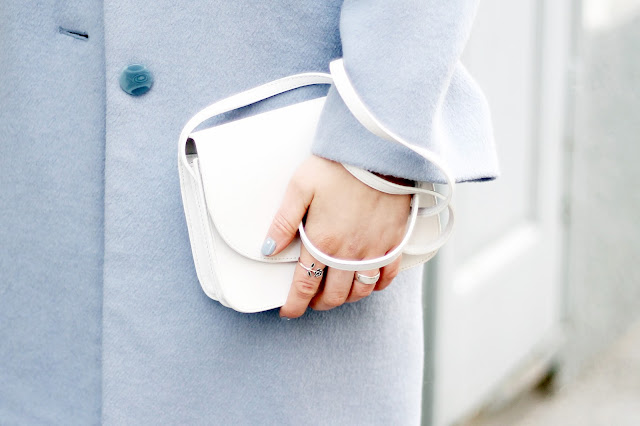white mini bag and pastel blue winter coat