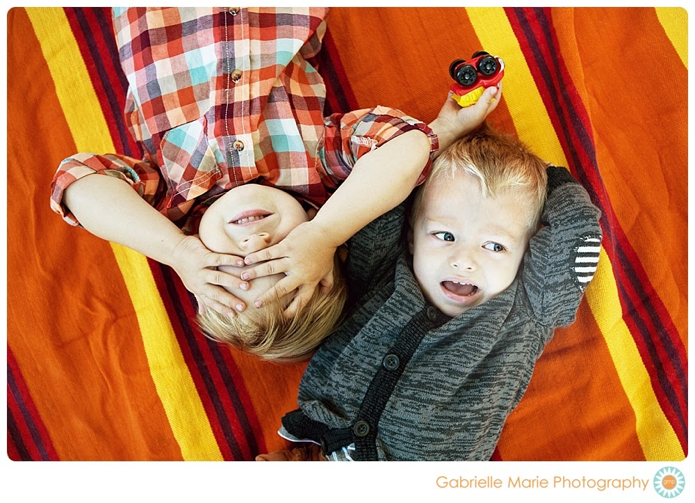 Two young brothers on brightly colored blanket - Best of 2013 St. Louis Family Portraits