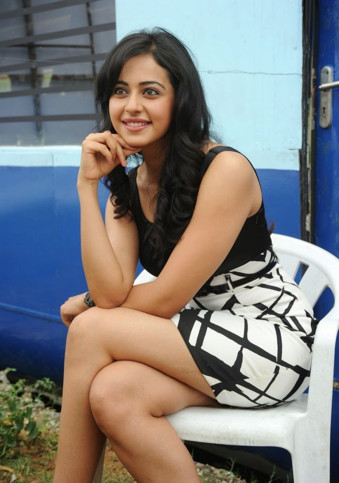 bollywood-tollywood actress Rakul Preet Singh sitting cross-leged on white chair looks very sexy hot pics free download hd 1080p resolution sexy hot pics of Rakul Preet Singh