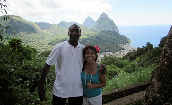 Photo of people against the Pitons, St. Lucia