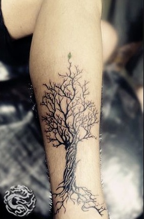 tree tattoo on the leg