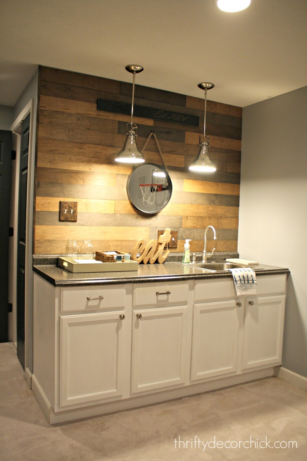 My new favorite wood planked wall from thrifty decor chick for Basement kitchenette with bar