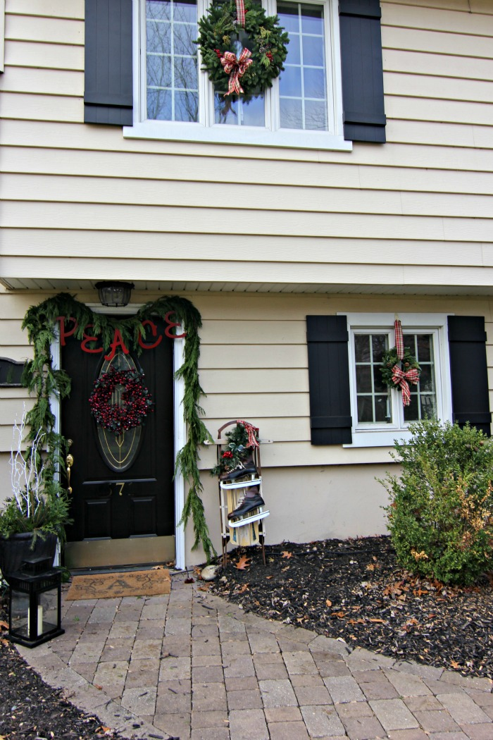 Window with fresh wreath and black board and batten shutters - www.goldenboysandme.com