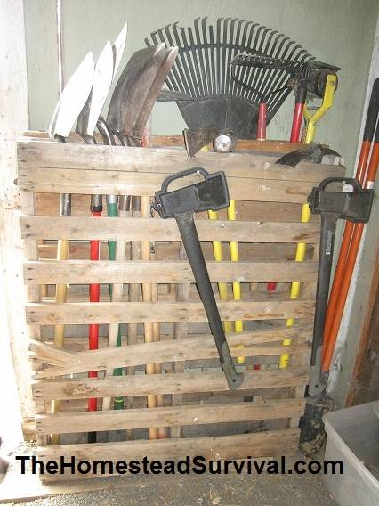 Recycle a wooden pallet to use as yard tool storage in the for Diy garden tool storage
