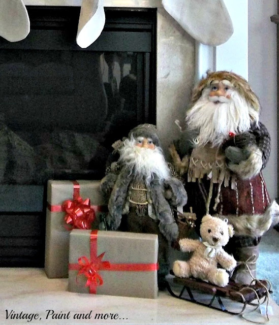 Vintage, Paint and more... Christmas mantel with vintage Santas and sleigh,  brown paper wrapped packages